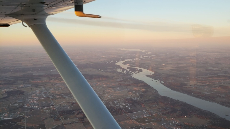 Pilot view over the mississippi river in a cessna skyhawk