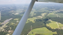 Copilot wing view over grass lands