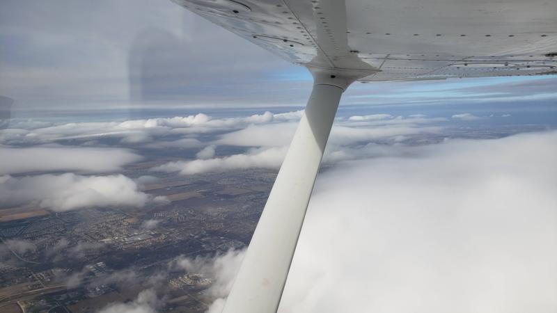 Cessna Skyhawk Flying Past Flat Top Clouds