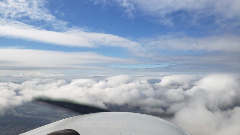 Foreword View From Cessna Skyhawk Over A Broken Cloud Layer