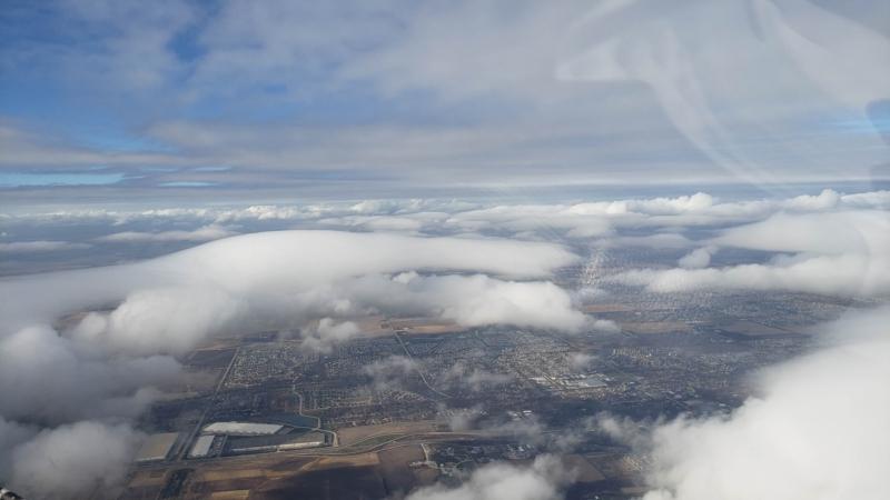 Broken cloud layer over flight
