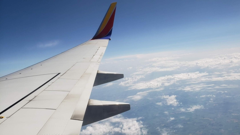 Southwest Jet Wing View Over Developing Storms